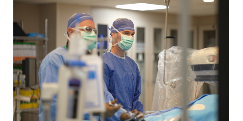 Adam Harless, MD, interventional cardiologist, right, performs a procedure in one of Forrest General's cath labs.