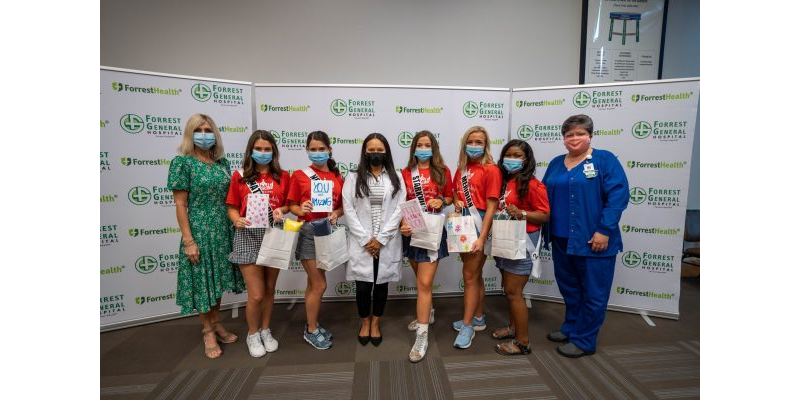 Forrest Health Vice President Millie Swan, left, poses with Mississippi Miss Hospitality contestants, Radiation Oncologist, Sophy Mangana, MD, center, FGH Cancer Center Patient Navigator, Ramona Martin, RN.